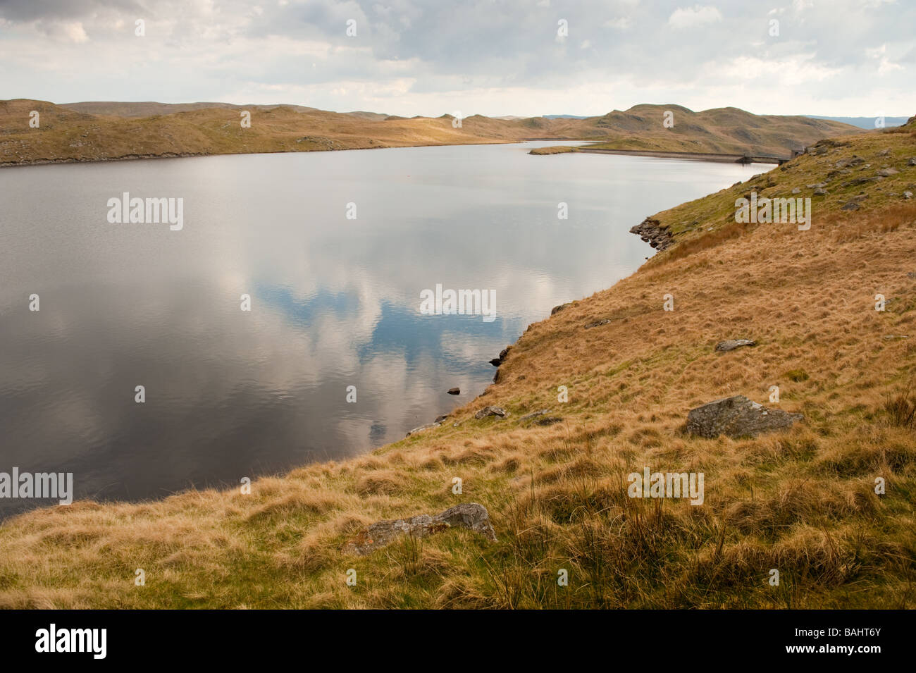 Reflections of clouds in Llyn Teifi Lake in remote upland Ceredigion Wales UK Stock Photo