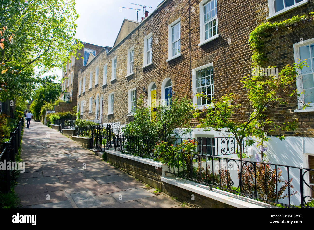 Spring in Hampstead Village , picturesque row of Georgian terraced cottages with sash windows & gardens in Flask - Stock Image