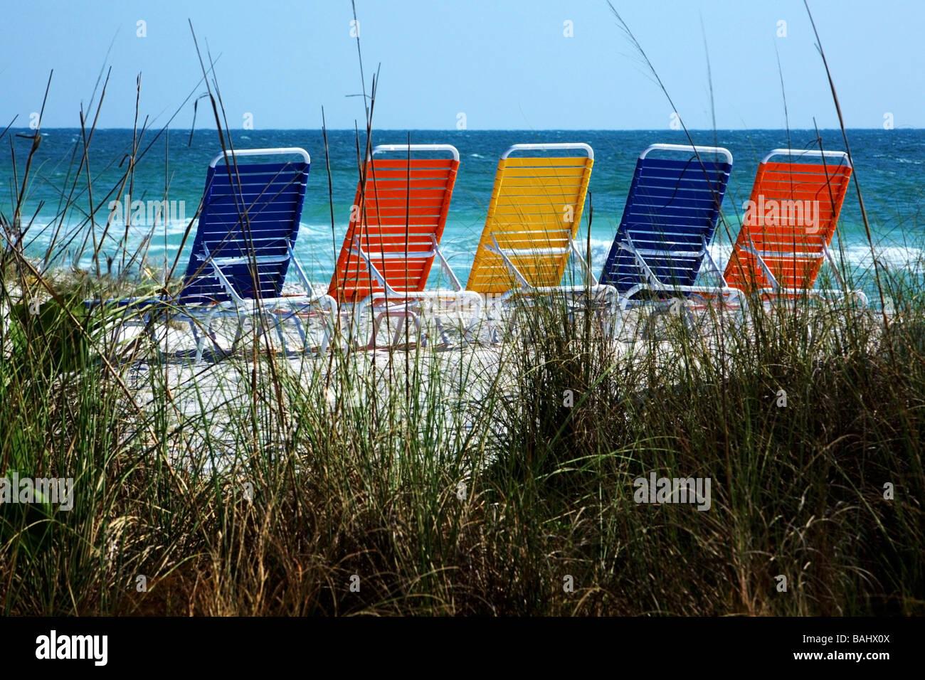 Bradenton Beach, Florida, USA; beach chairs lined on beach - Stock Image