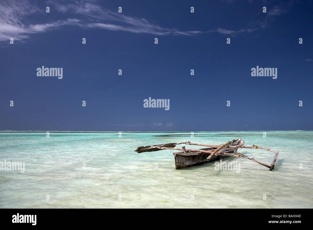 Zanzibar, Tanzania; Dhow in shallow water - Stock Image