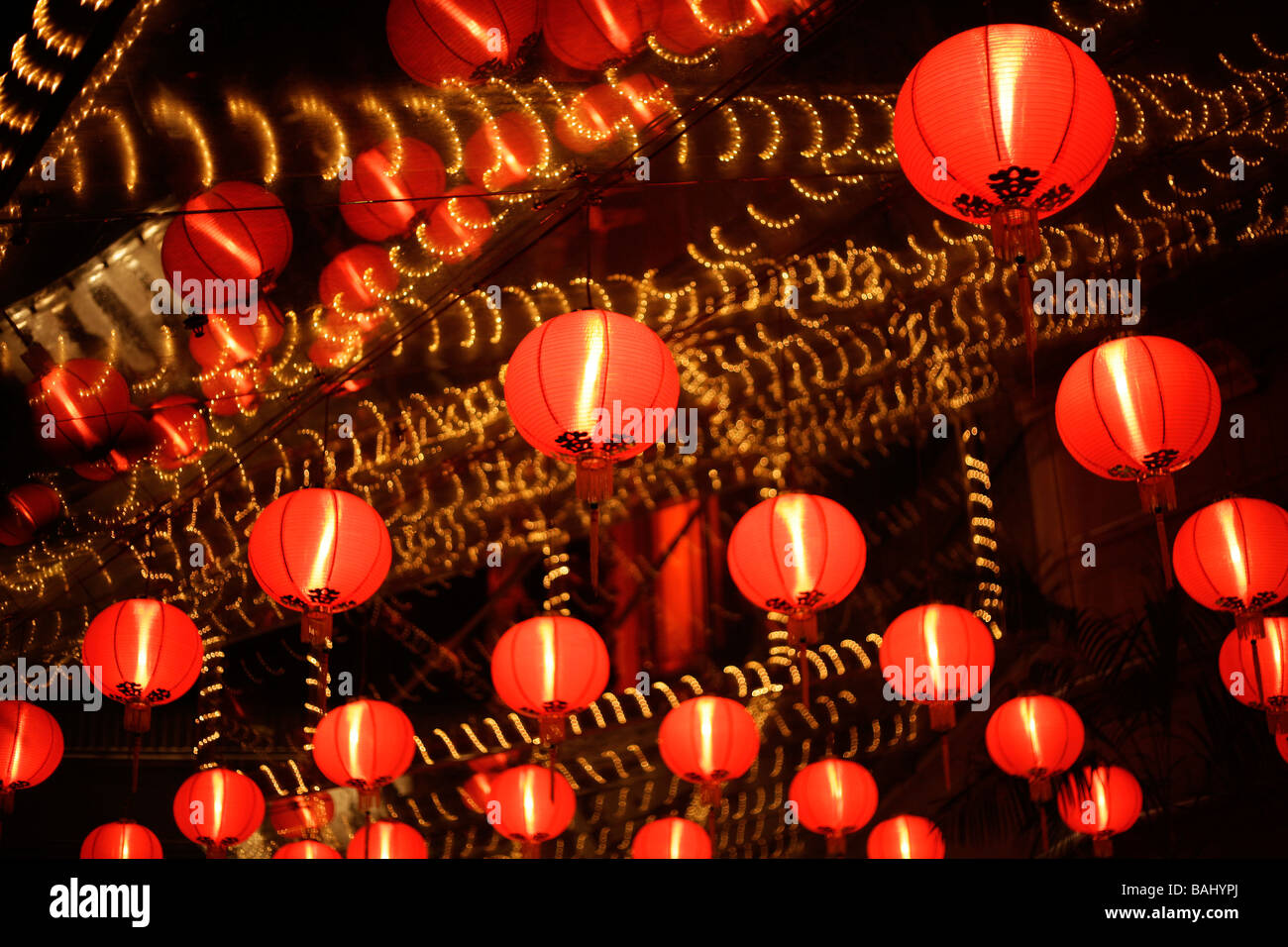 glowing red light of chinese new year lanterns in Singapore Asia - Stock Image