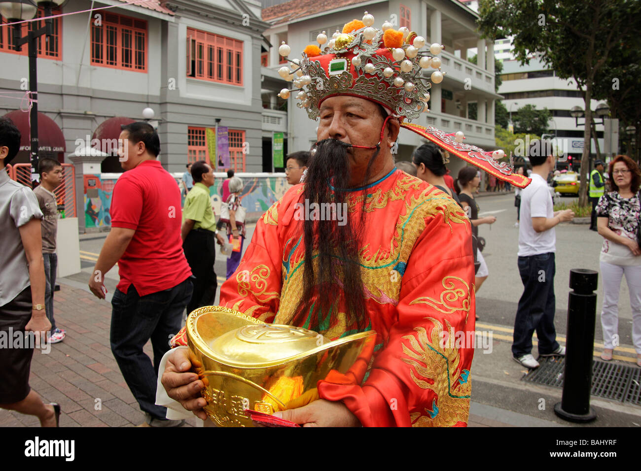chinese man with costume and fake beard during chinese new year in Singapore Asia - Stock Image