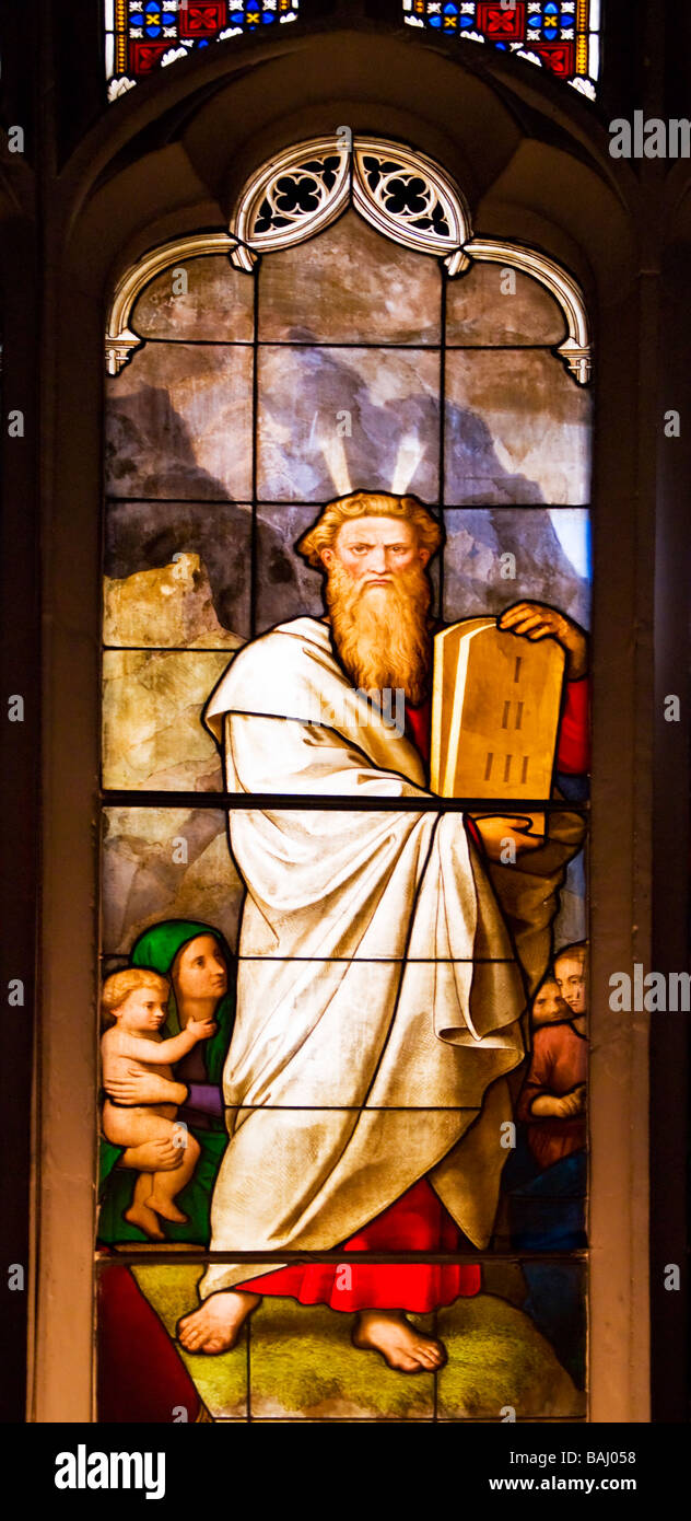 Cambridge, England, UK. Peterhouse College Chapel. Stained glass window. Moses with the Ten Commandments - Stock Image