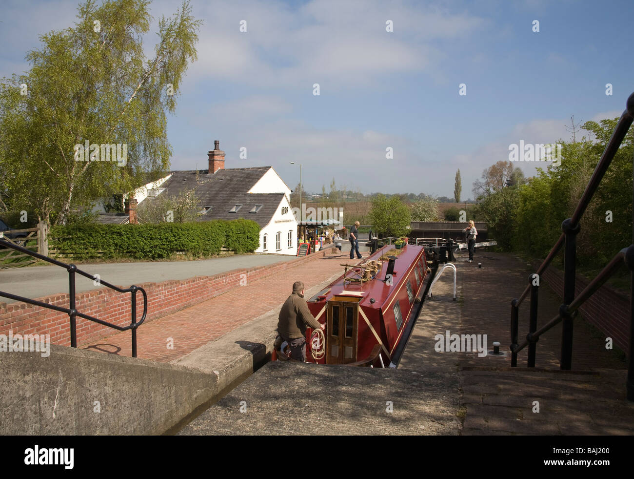 Grindley Brook Whitchurch Shropshire England UK April man in narrowboat in a lock waiting for it to empty on Llangollen - Stock Image