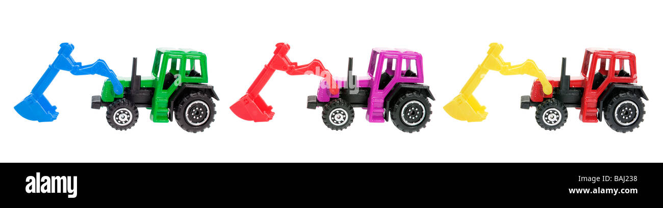 Miniature Plastic Earth Movers - Stock Image