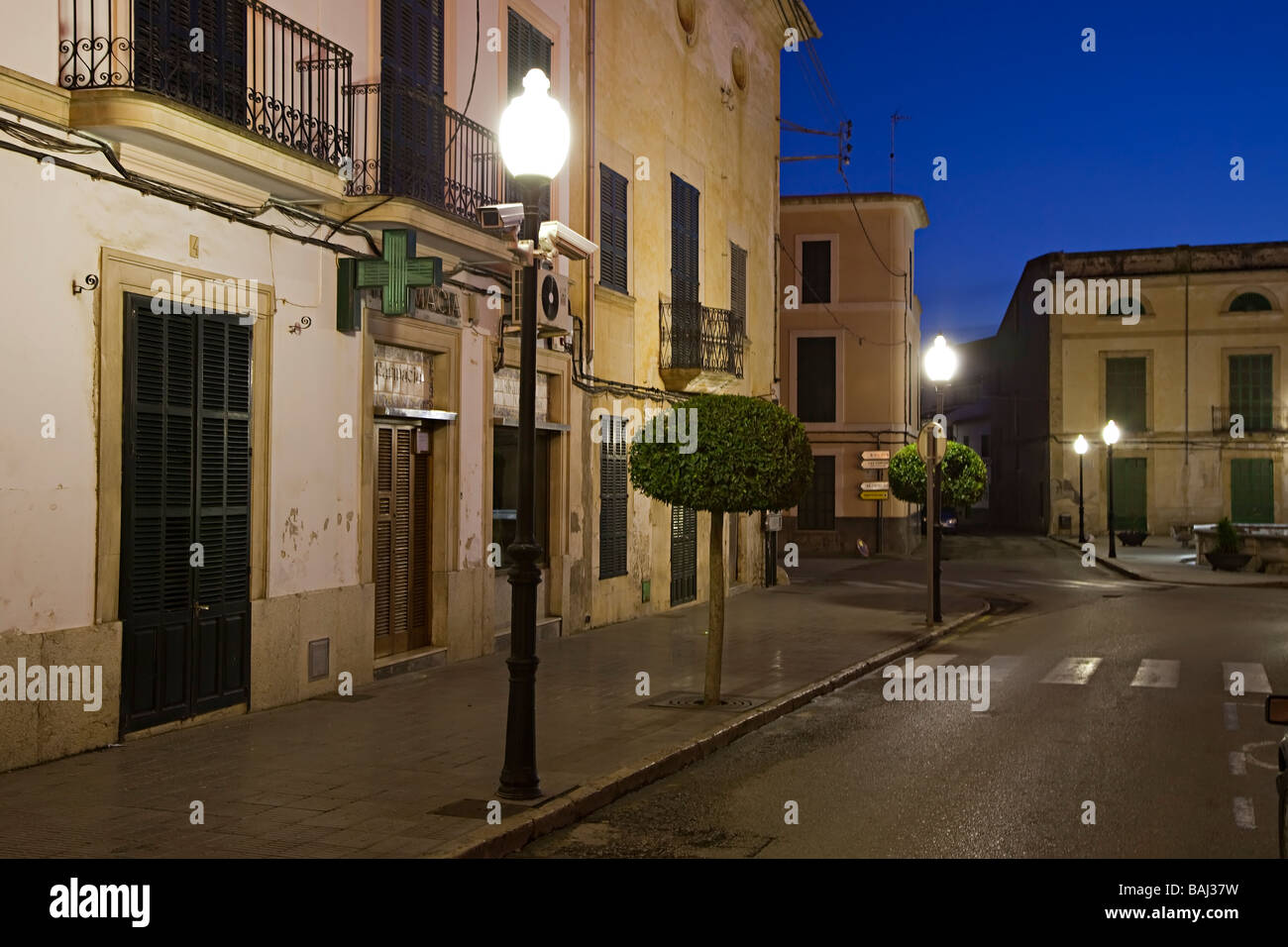 Empty street at dusk with security cameras on lamp post Felanitx Mallorca Spain - Stock Image