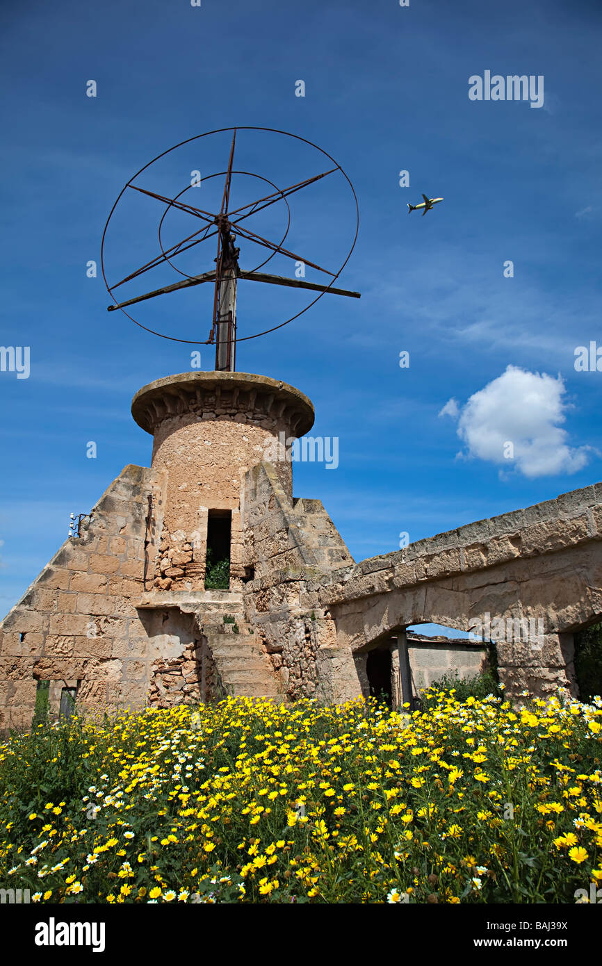Windmill with package holiday aeroplane flying past Mallorca Spain - Stock Image