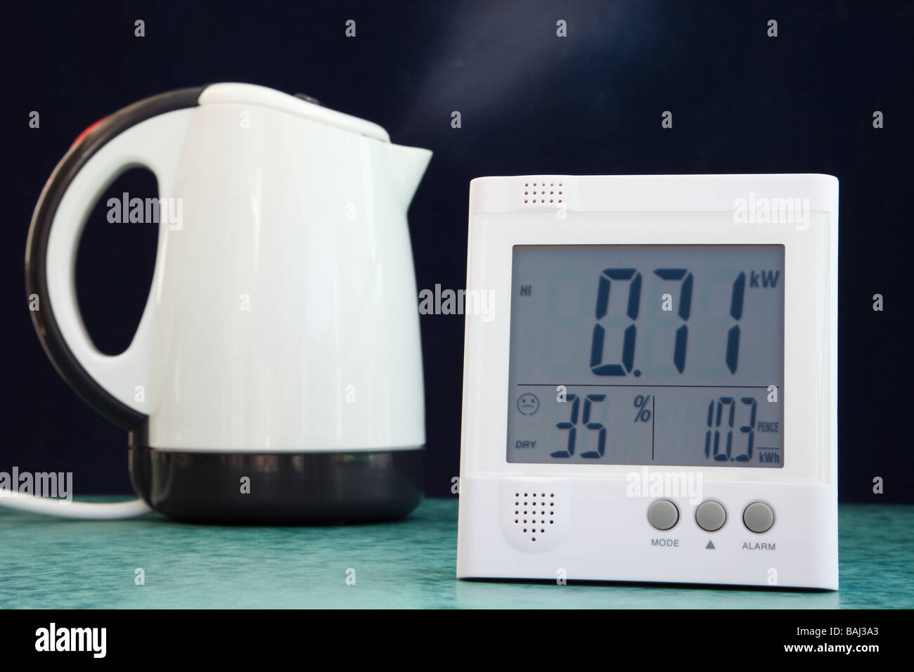 Wireless OWL energy monitor with LCD display showing number of kilowatts of domestic electricity being used with - Stock Image