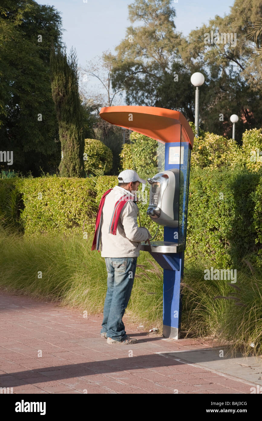 Marrakech Morocco North Africa Man using a public phone - Stock Image