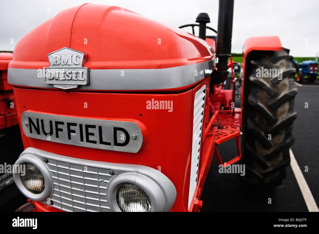 Front of a red Nuffield vintage farm tractor - Stock Image