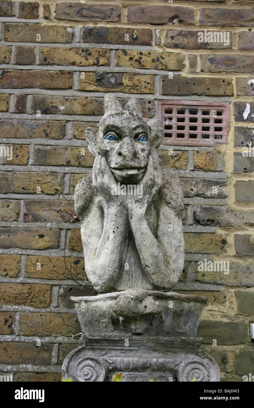 Close up of a Gargoyle on a wall - Stock Image