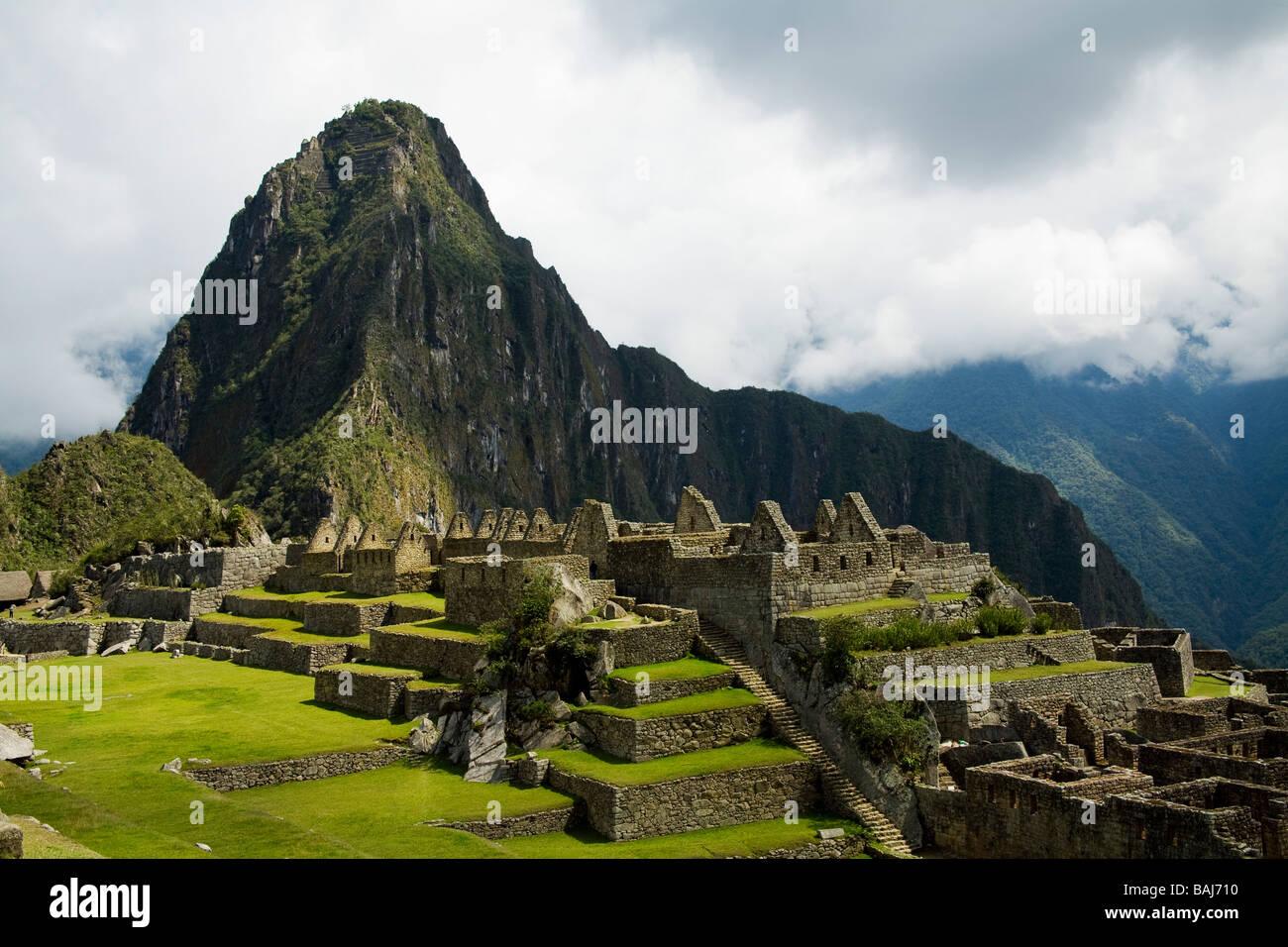 Huayna Picchu in the background at Machu Picchu, Peru - Stock Image