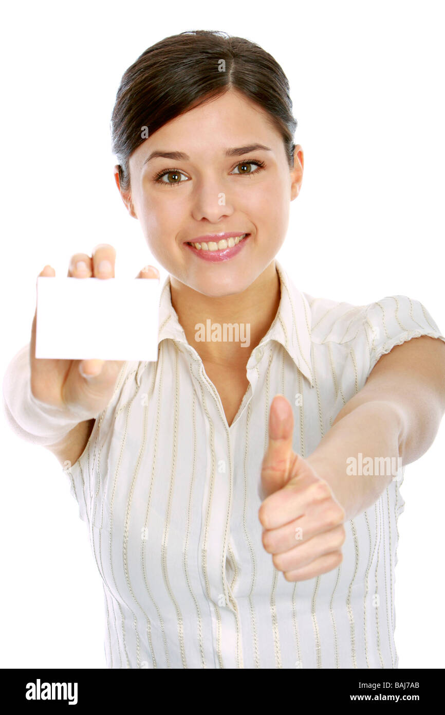 young woman holding blank business card, making ok sign - Stock Image