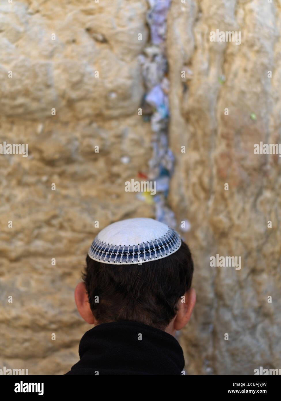 Israel Jerusalem Western Wall or Wailing Wall with worshiper Stock Photo