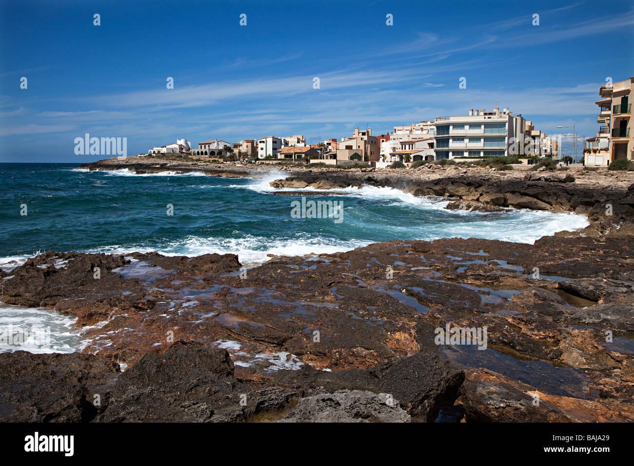 Rocky coastline and hotels Colonia de Sant Jordi Mallorca Spain - Stock Image
