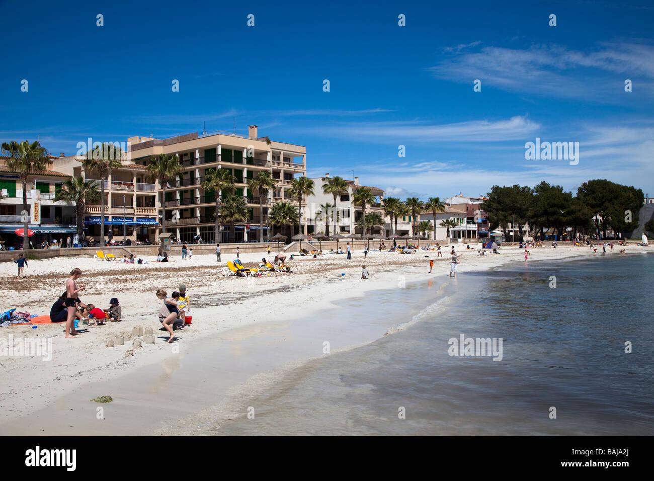 Children playing on beach Colonia de Sant Jordi Mallorca Spain - Stock Image