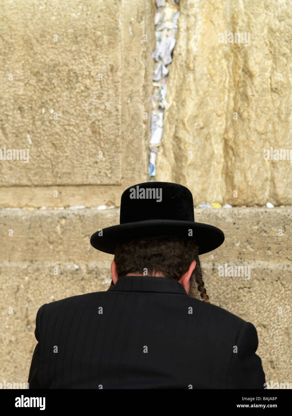 Israel, Jerusalem, Western Wall or Wailing Wall with worshiper - Stock Image