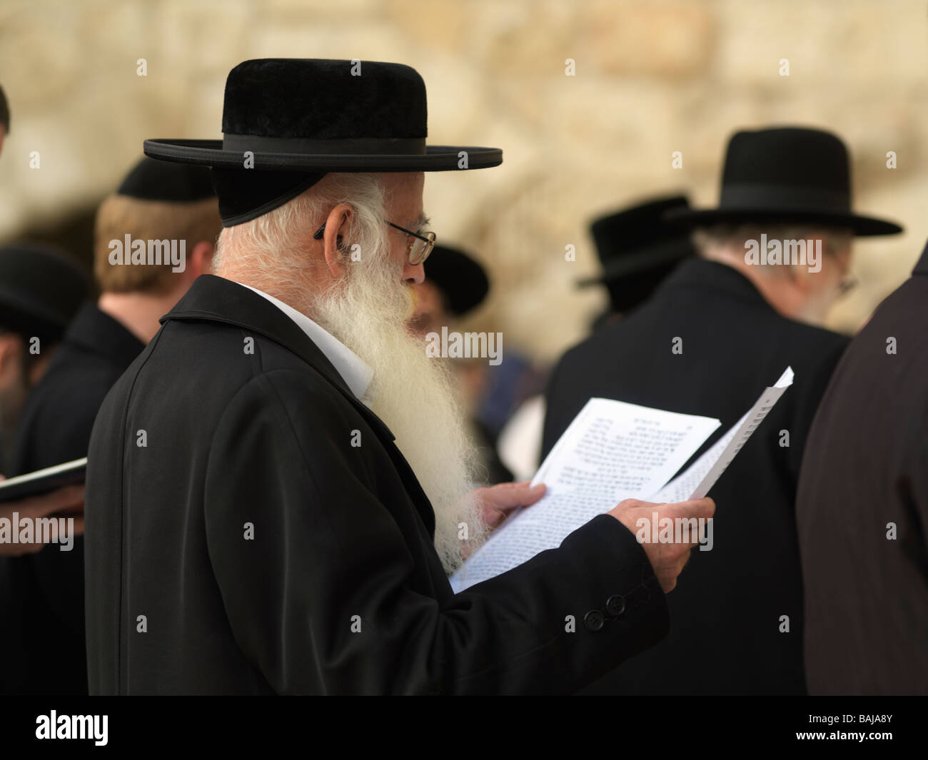Israel Jerusalem Western Wall or Wailing Wall with worshipers - Stock Image