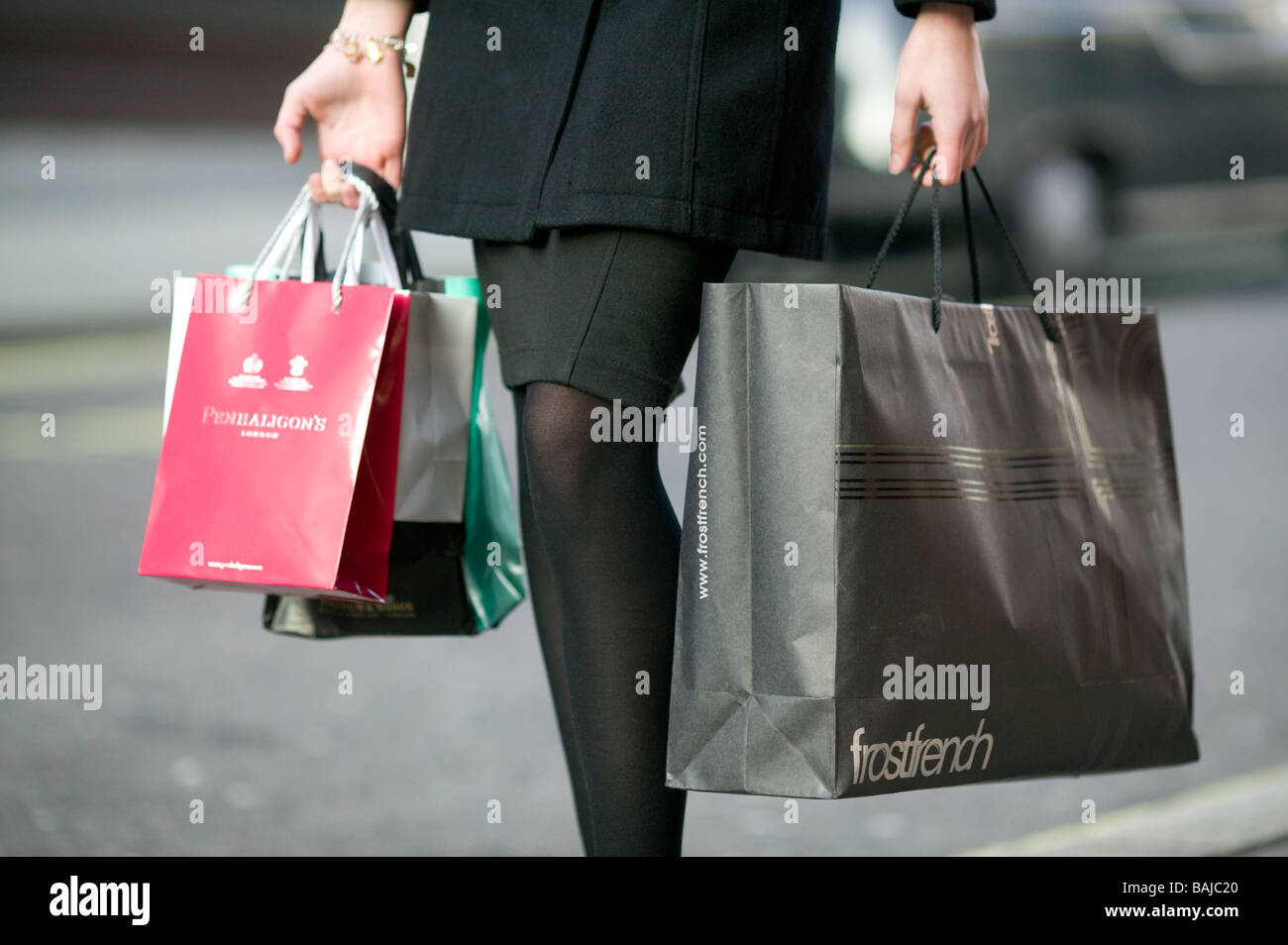4cf99e5f8 shopping bags from exclusive shops carried by a young woman in Soho ...