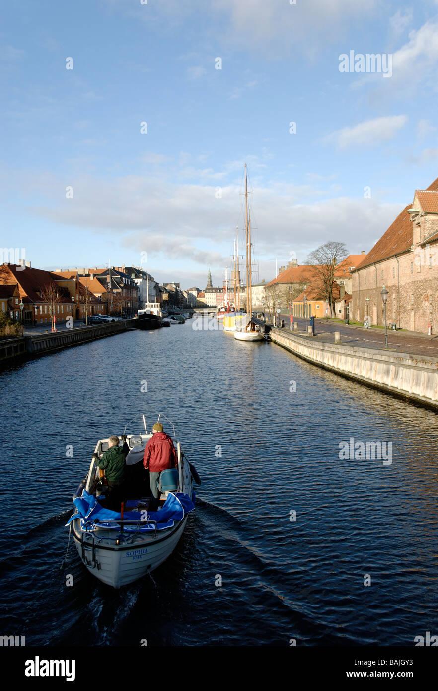Boat along Frederiksholms Kanal, Copenhagen  Denmark - Stock Image