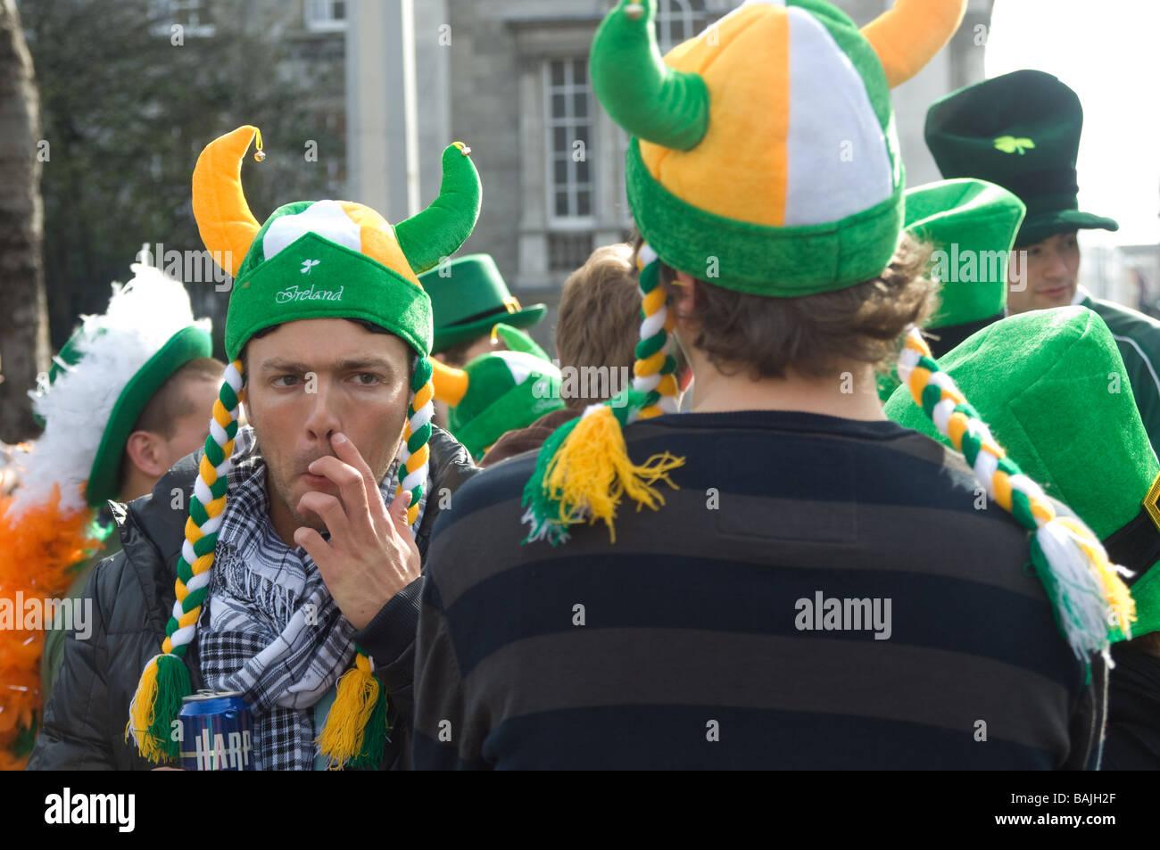 Men wearing viking hats in crowd at St Parick's Day parade, Dublin, Ireland Stock Photo