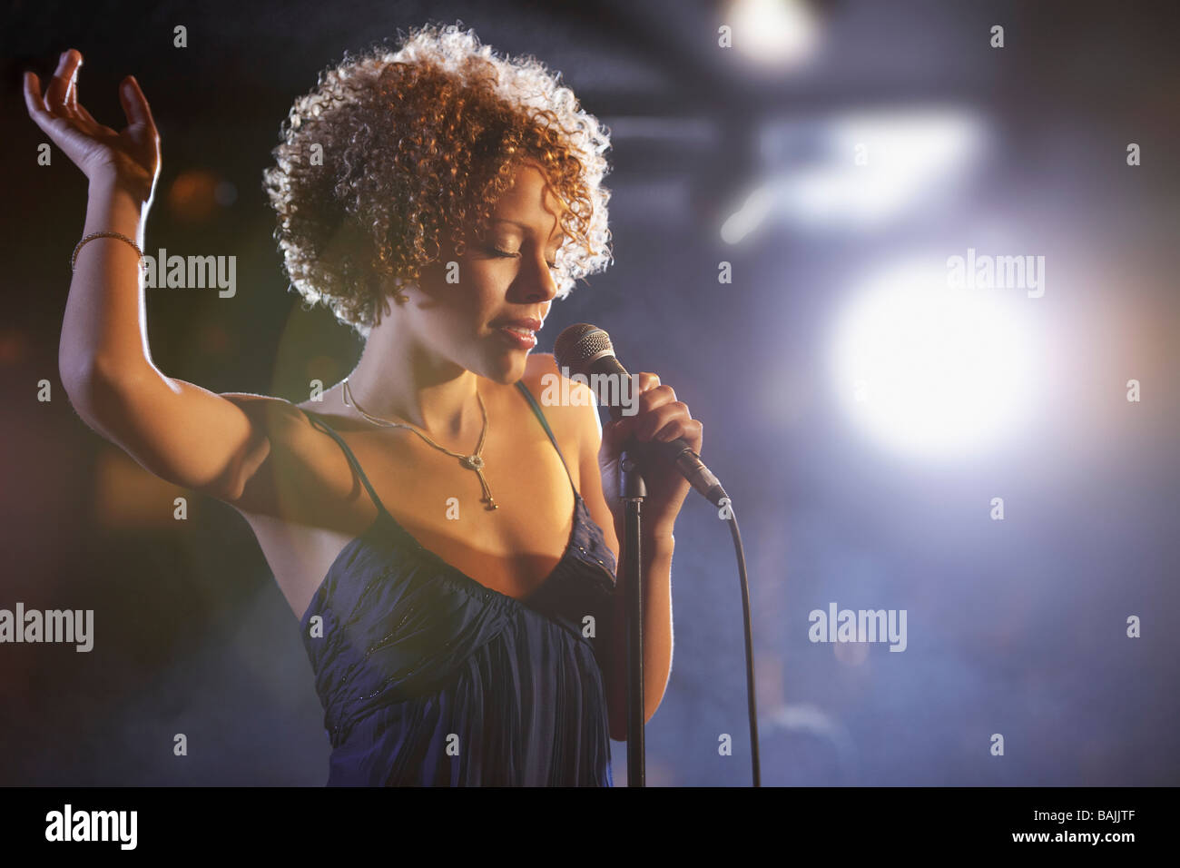 Jazz singer on stage, portrait - Stock Image