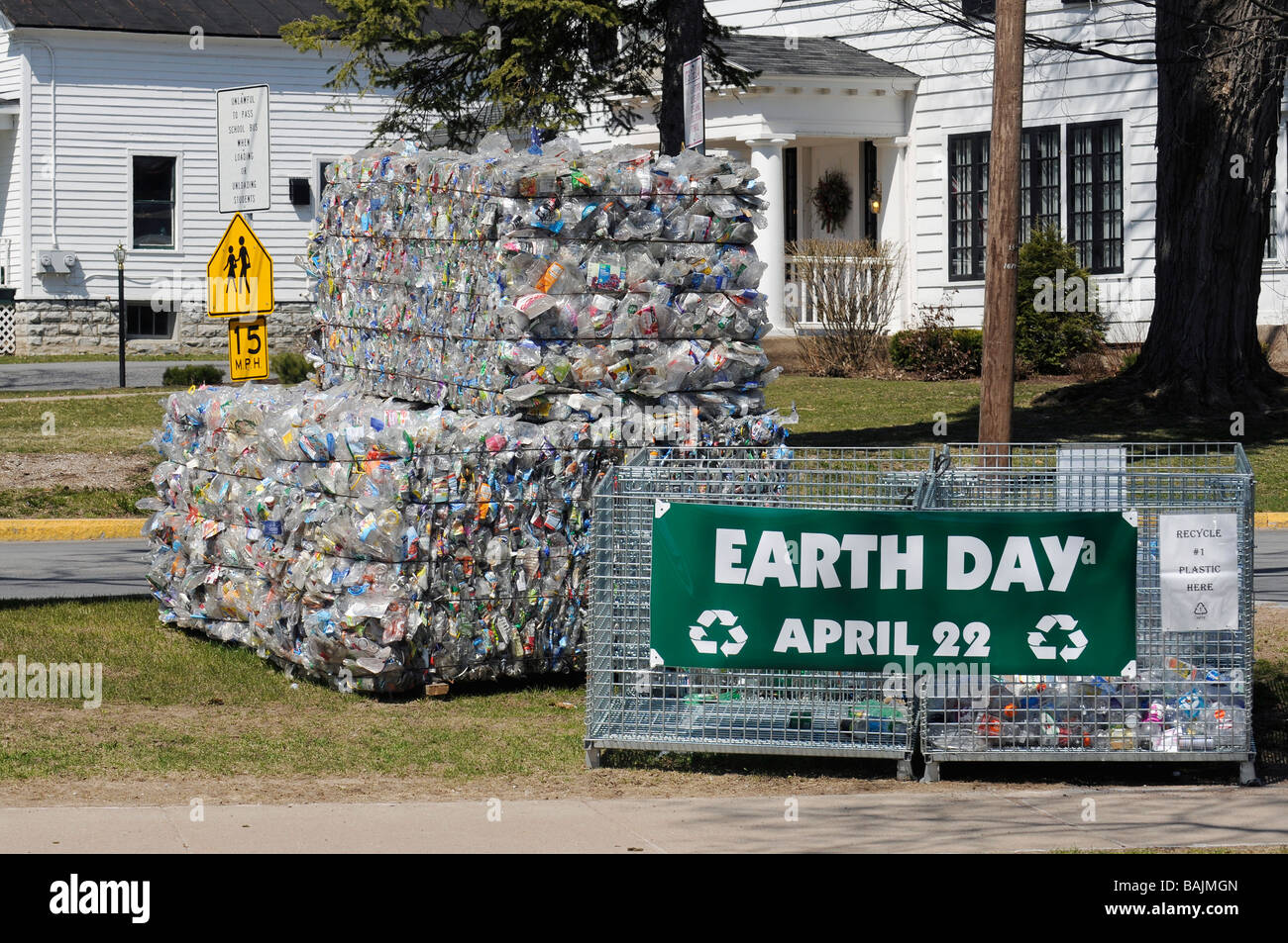 Earth day display of material ready for recycling in Lowville New York - Stock Image