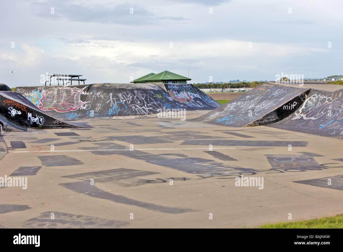 deserted skateboard park with graffiti - Stock Image