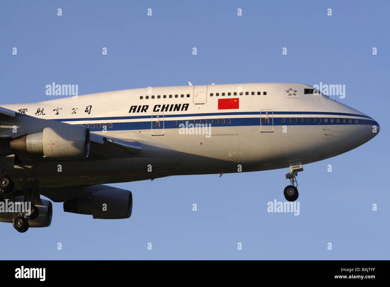 Air China Boeing 747-400 jumbo jet plane arriving at dawn. Close up view. - Stock Image