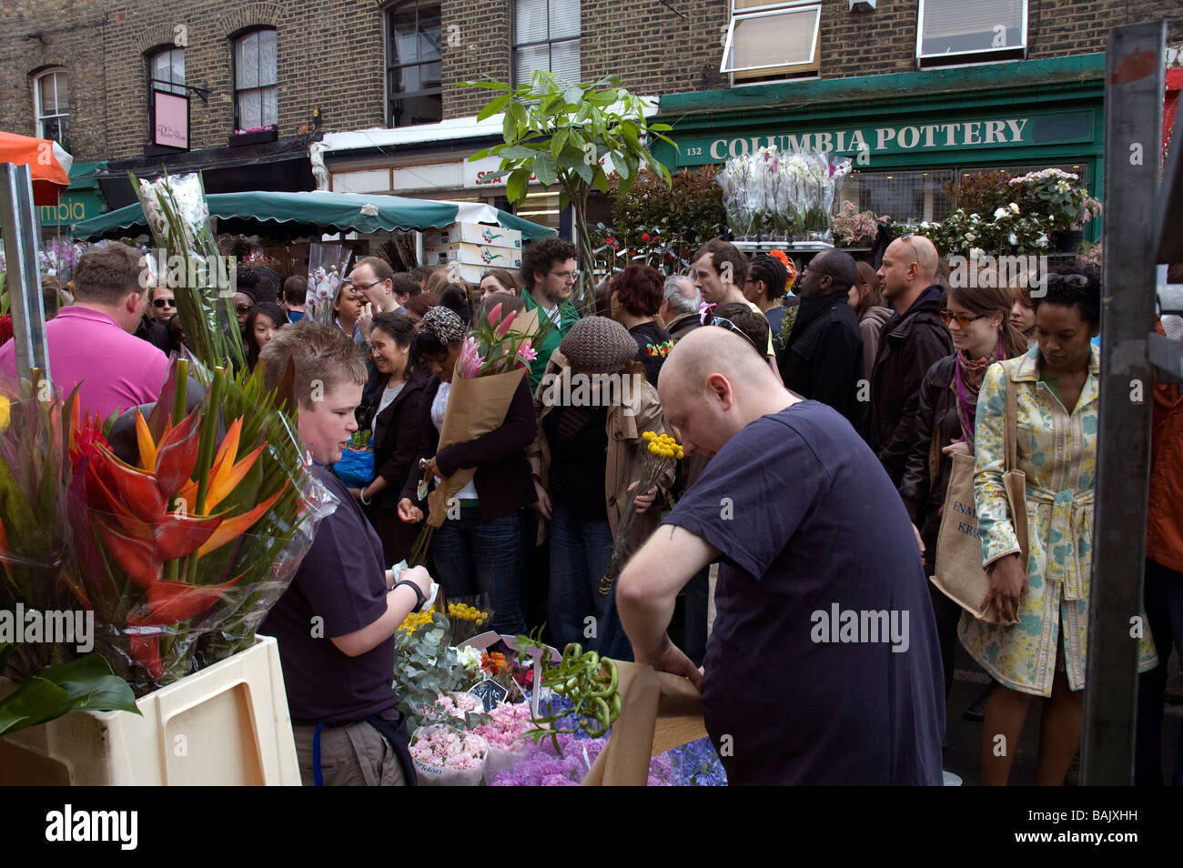 Locals and visitors at Columbia Rd Sunday Flower Market London England - Stock Image