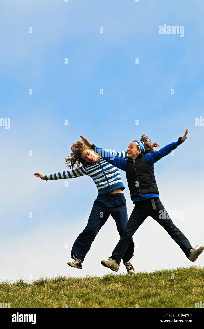action portrait of girls jumping - Stock Image