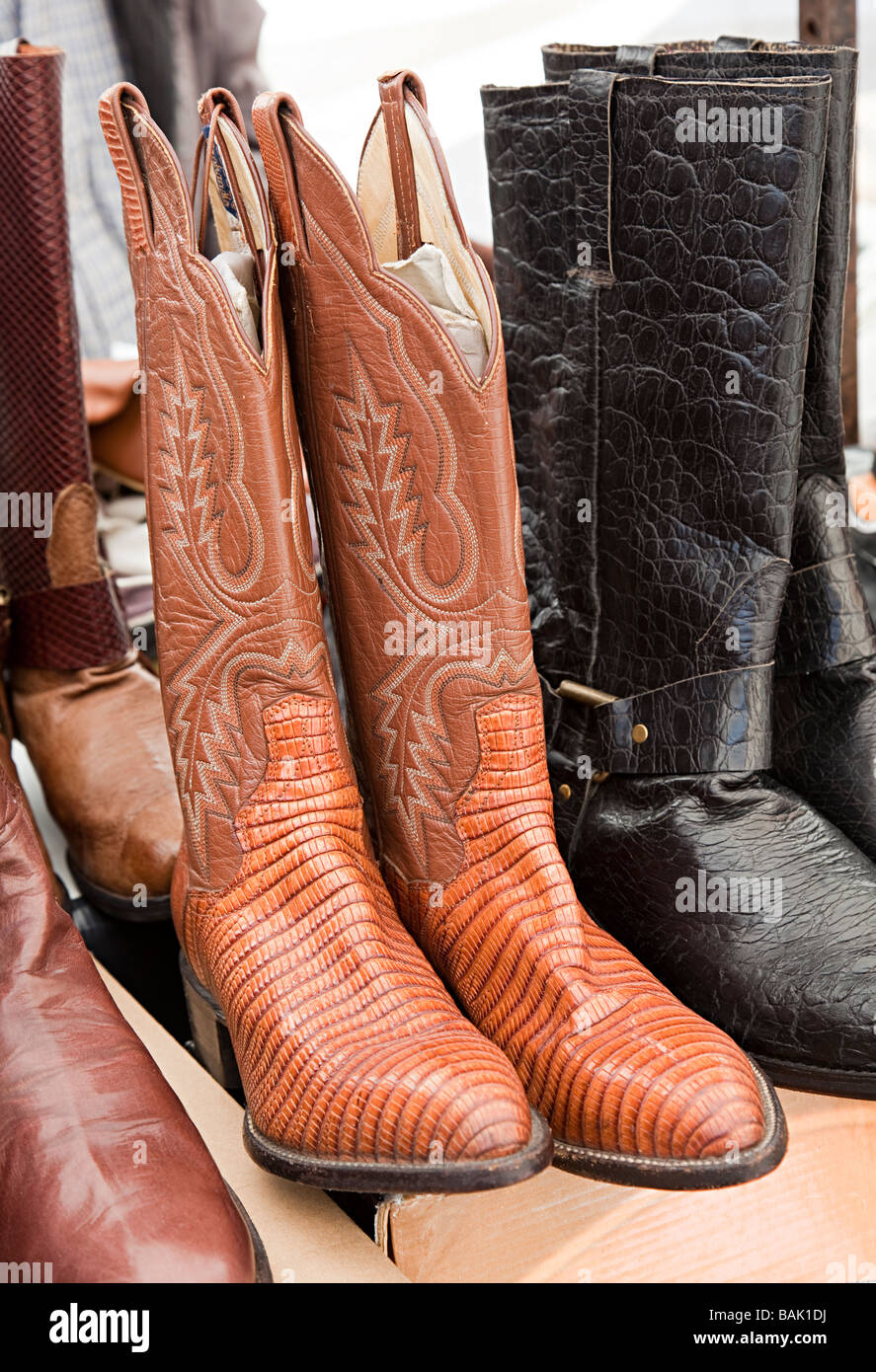 Tooled and decorated leather boots in tourist market Sineu Mallorca Spain - Stock Image