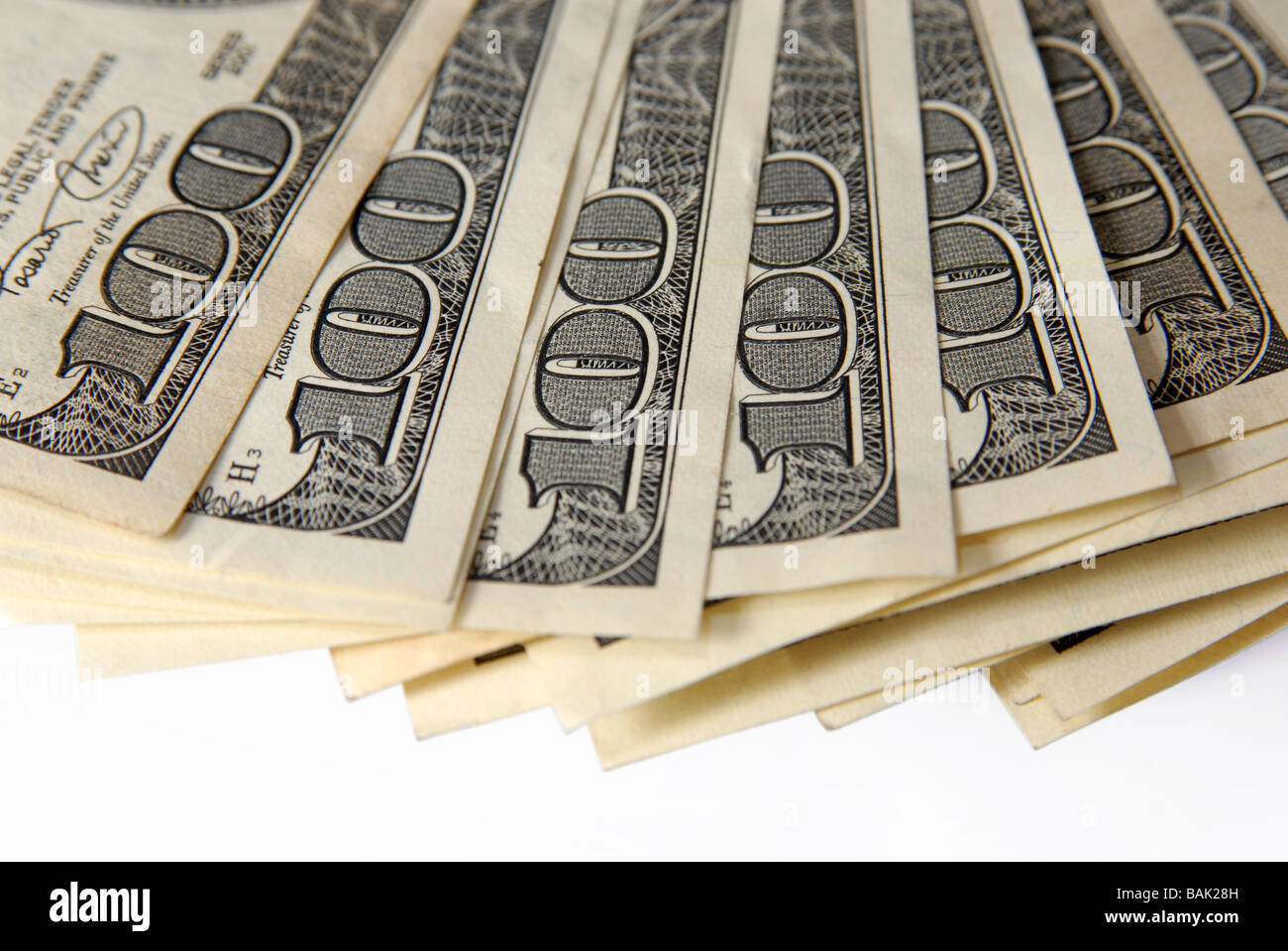 Close up of a thumb with one hundred dollar bill - Stock Image