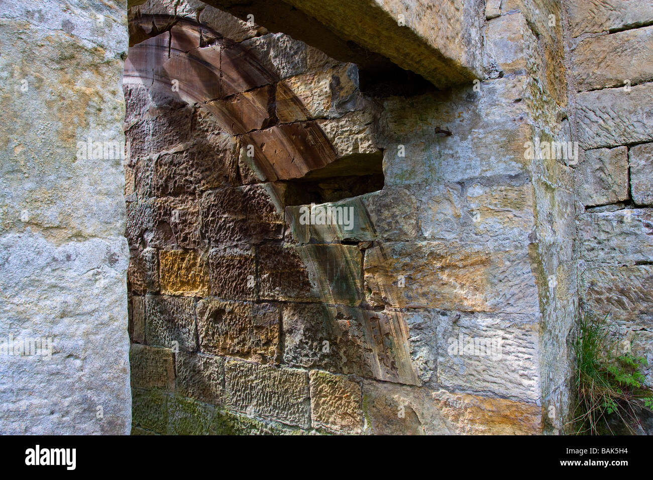 Detail of worn stone on old mill on the river coquet where the water wheel has been rubbing as it turned - Stock Image