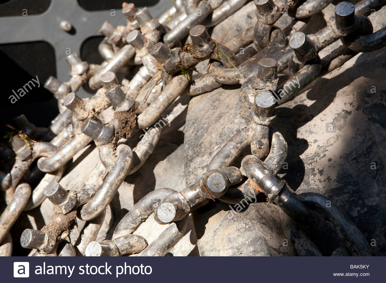 Friction chains are used on forest harvesters to give better grip on ice - Stock Image