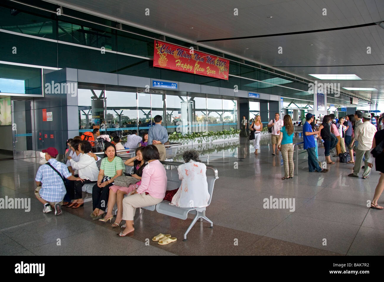 People Waiting To Greet Passengers Arriving At The Tan Son Nhat