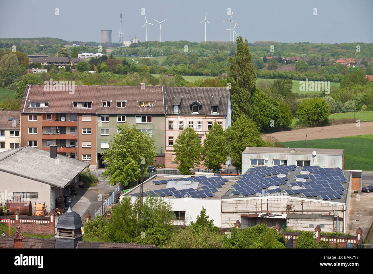 Landscape with wind turbines and solar batteries on roofs in Dortmund ,Germany. - Stock Image