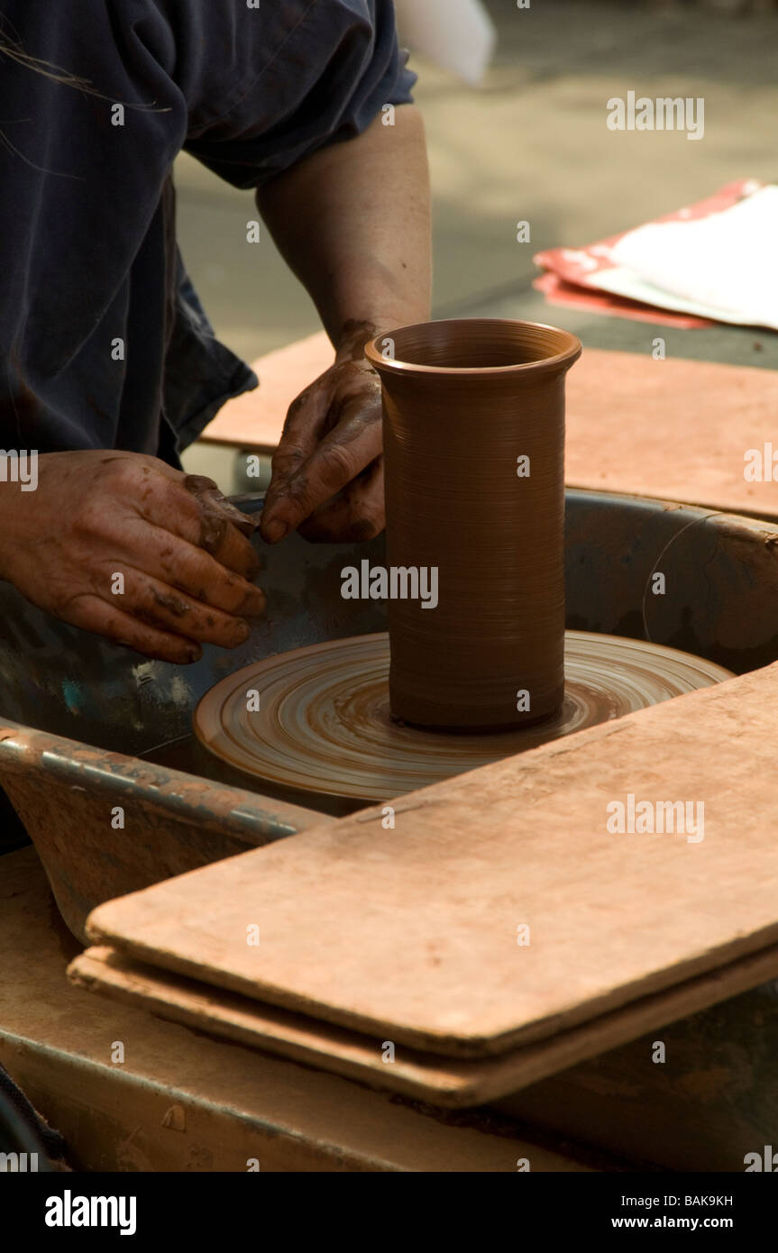 potters wheel pot turning clay molding spin turn pottery potter pot craft skill hobby handmade hobbies potter's - Stock Image