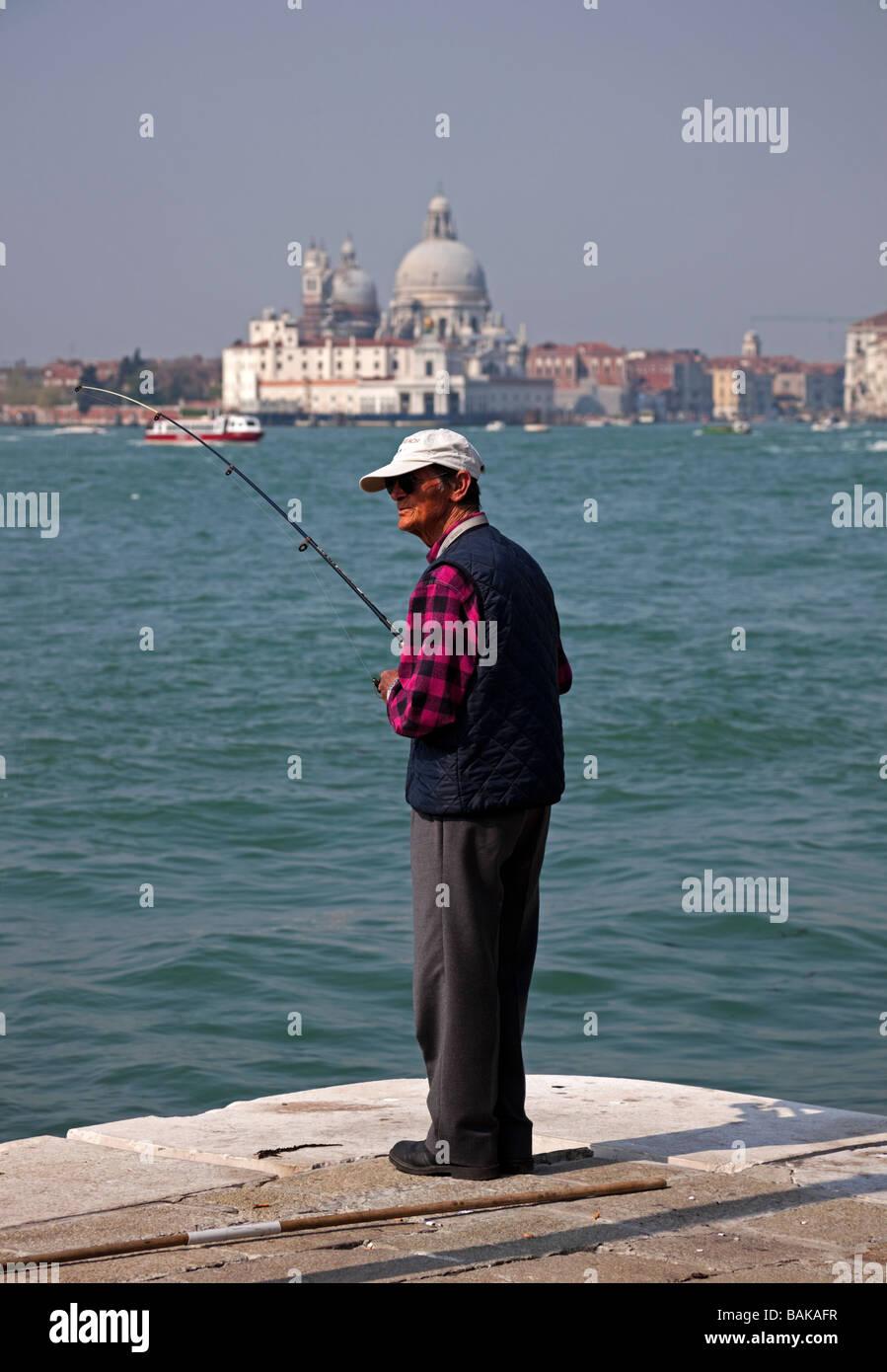 old Male fishing Bacino di San Marco Venice Italy relaxing leisure - Stock Image