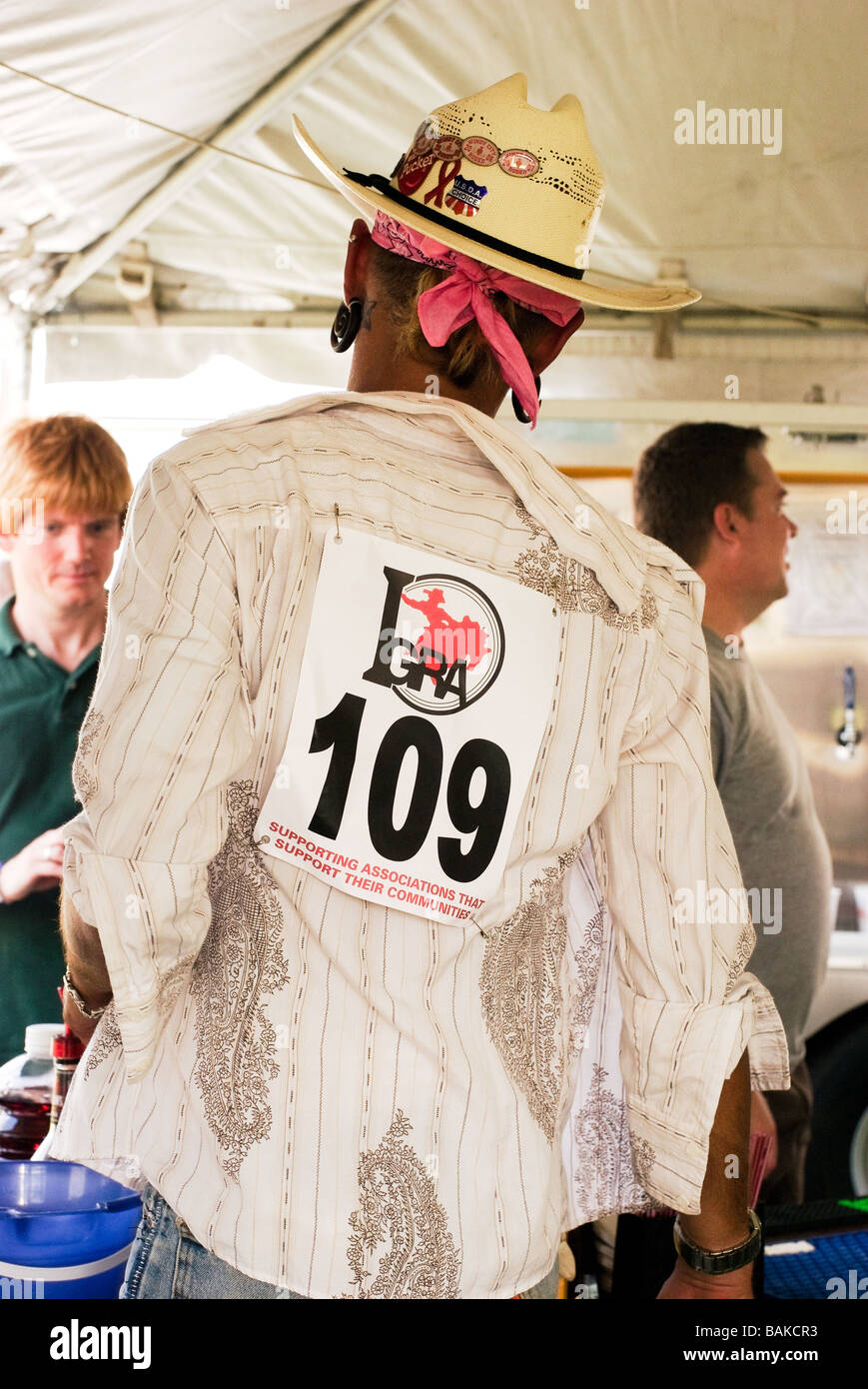 Caucasian male competitor wearing his number tag at the Windy City Rodeo a gay rodeo held annually near Chicago - Stock Image