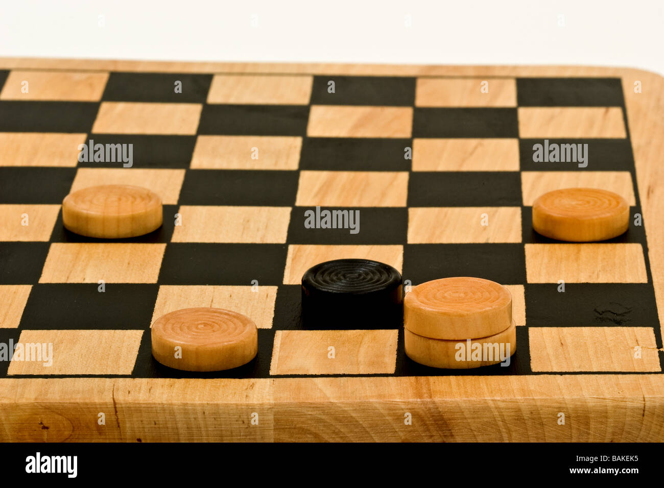 Checkers on a checkerboard at the end of the game - Stock Image