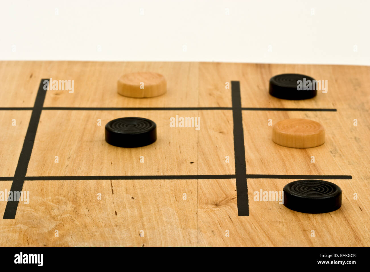 Winning tic-tac-toe pieces on a board - Stock Image