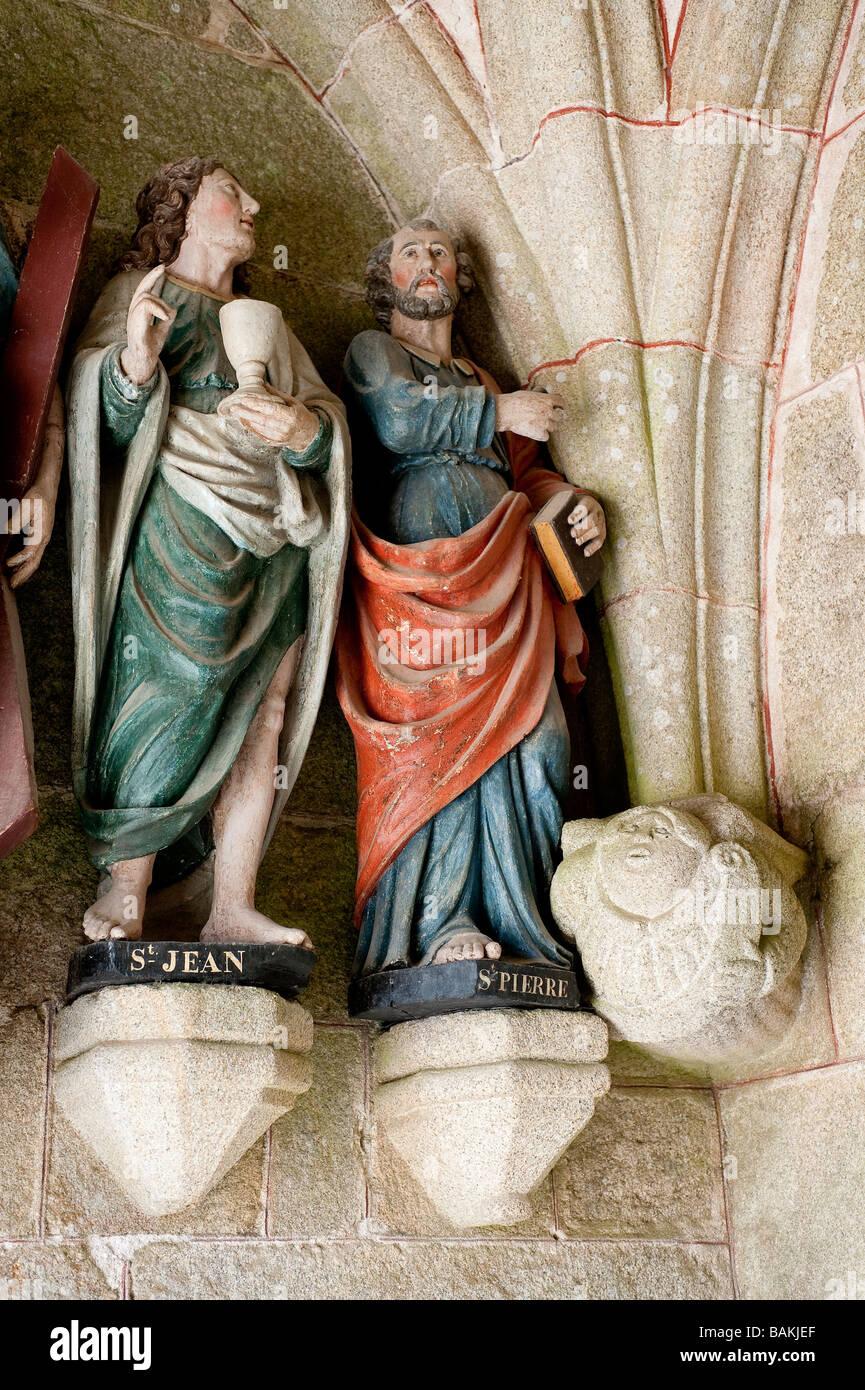 France, Cotes d'Armor, enclos paroissial de Tredrez, evangelists at the entrance of Church Stock Photo