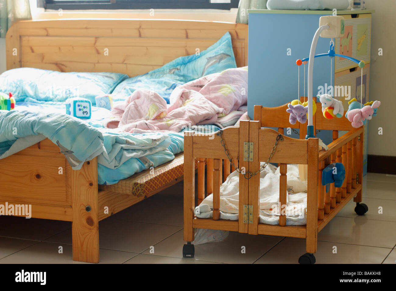 Baby Cradle Next Parents Bed High Resolution Stock Photography And Images Alamy