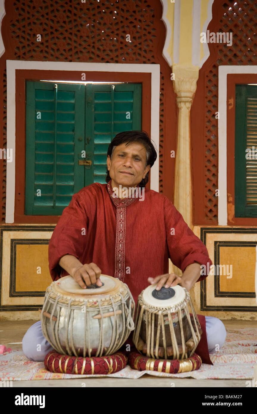 Jaipur City Palace of Jai Singh II Musician inside the Chandra Mahal Rajasthan India - Stock Image