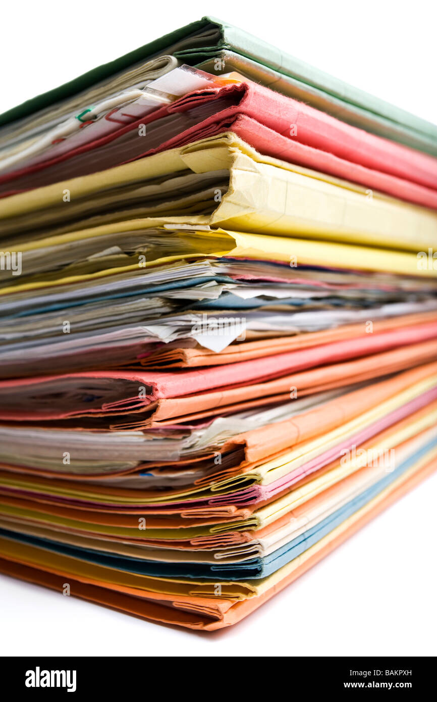 stack of stuffed file folders in various colors - Stock Image