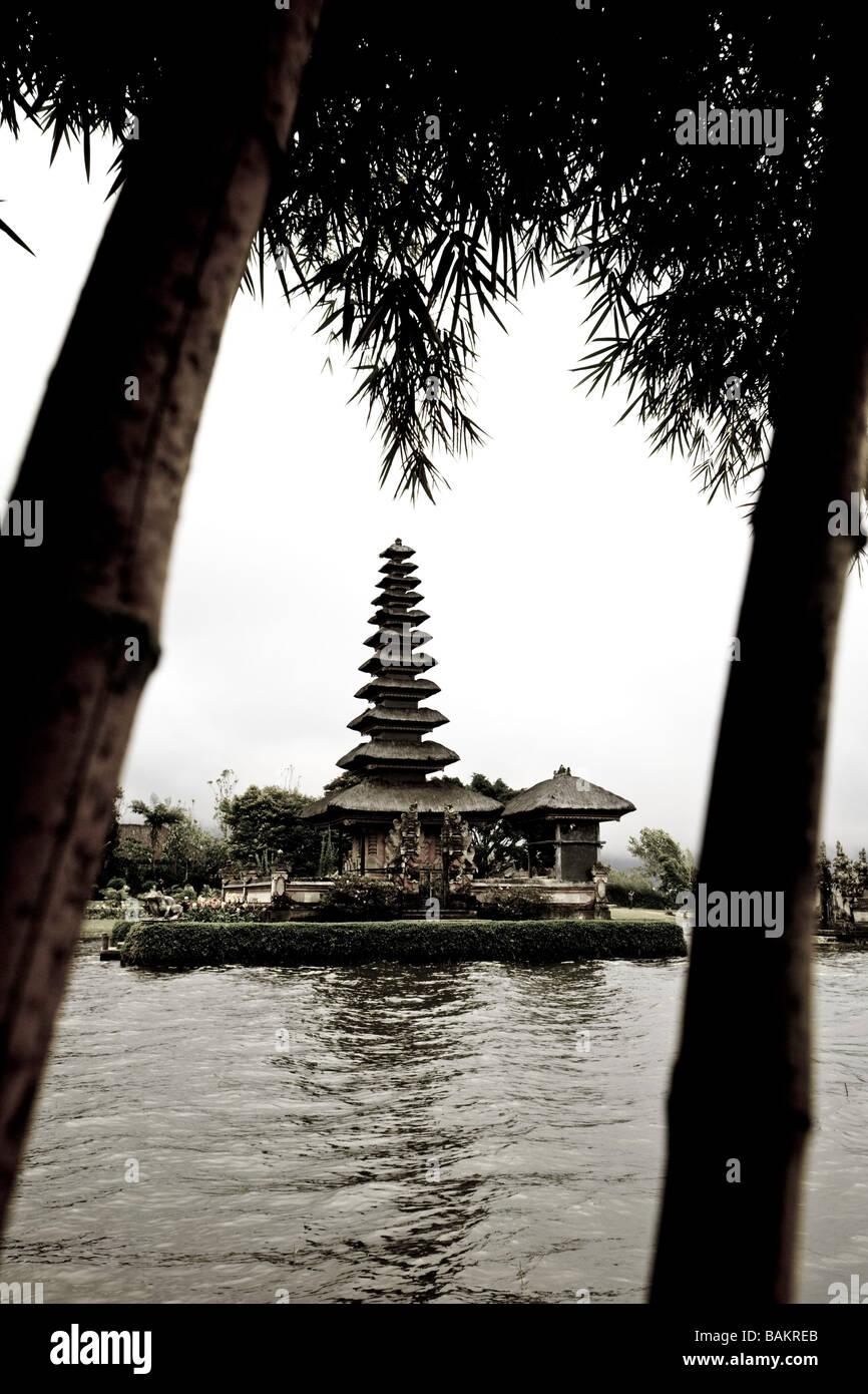 Indonesia, Bali. Bedugul, Lake Bratan. Pura Ulu Danu temple, bamboo trees. Stock Photo