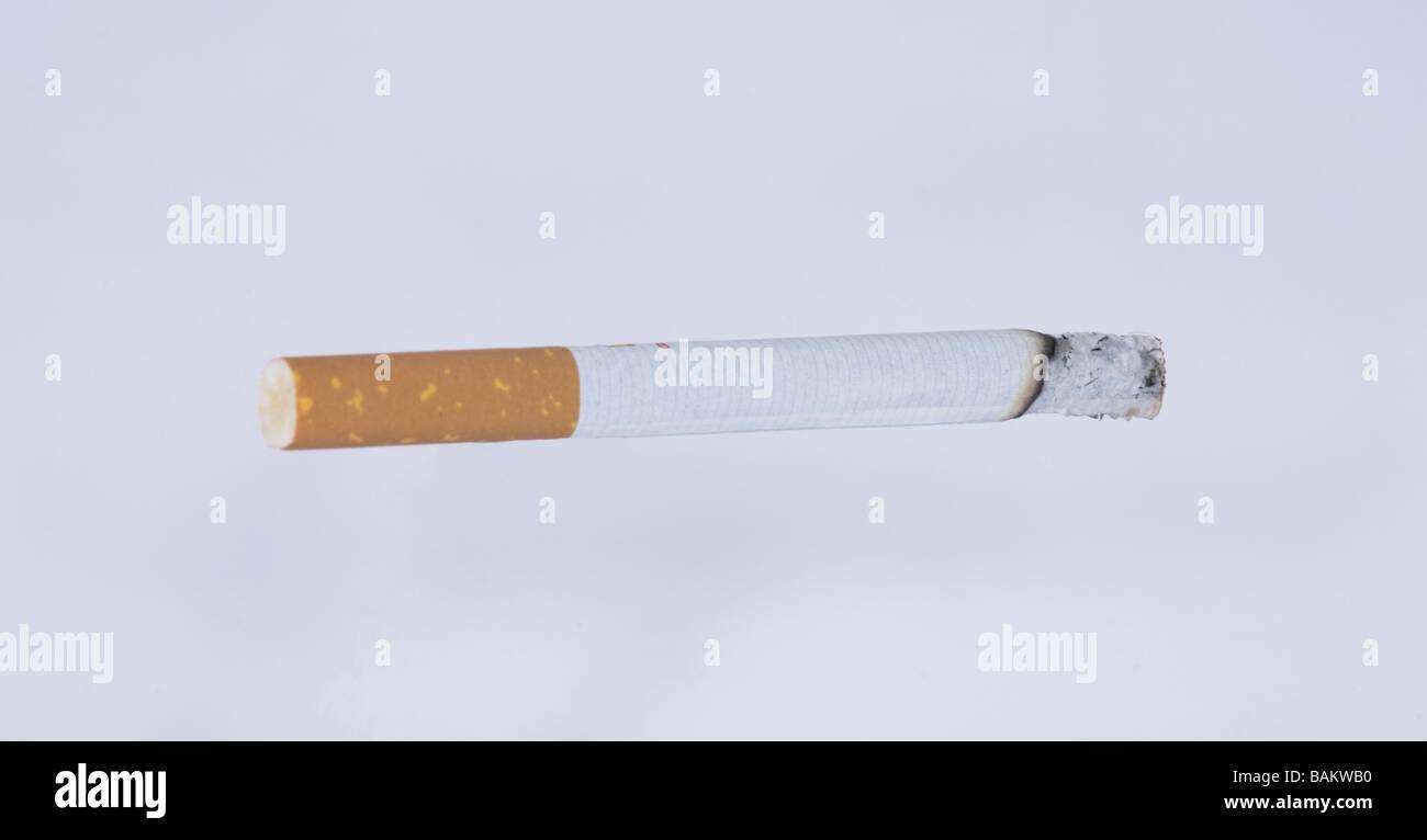 lite cigarette burning - Stock Image