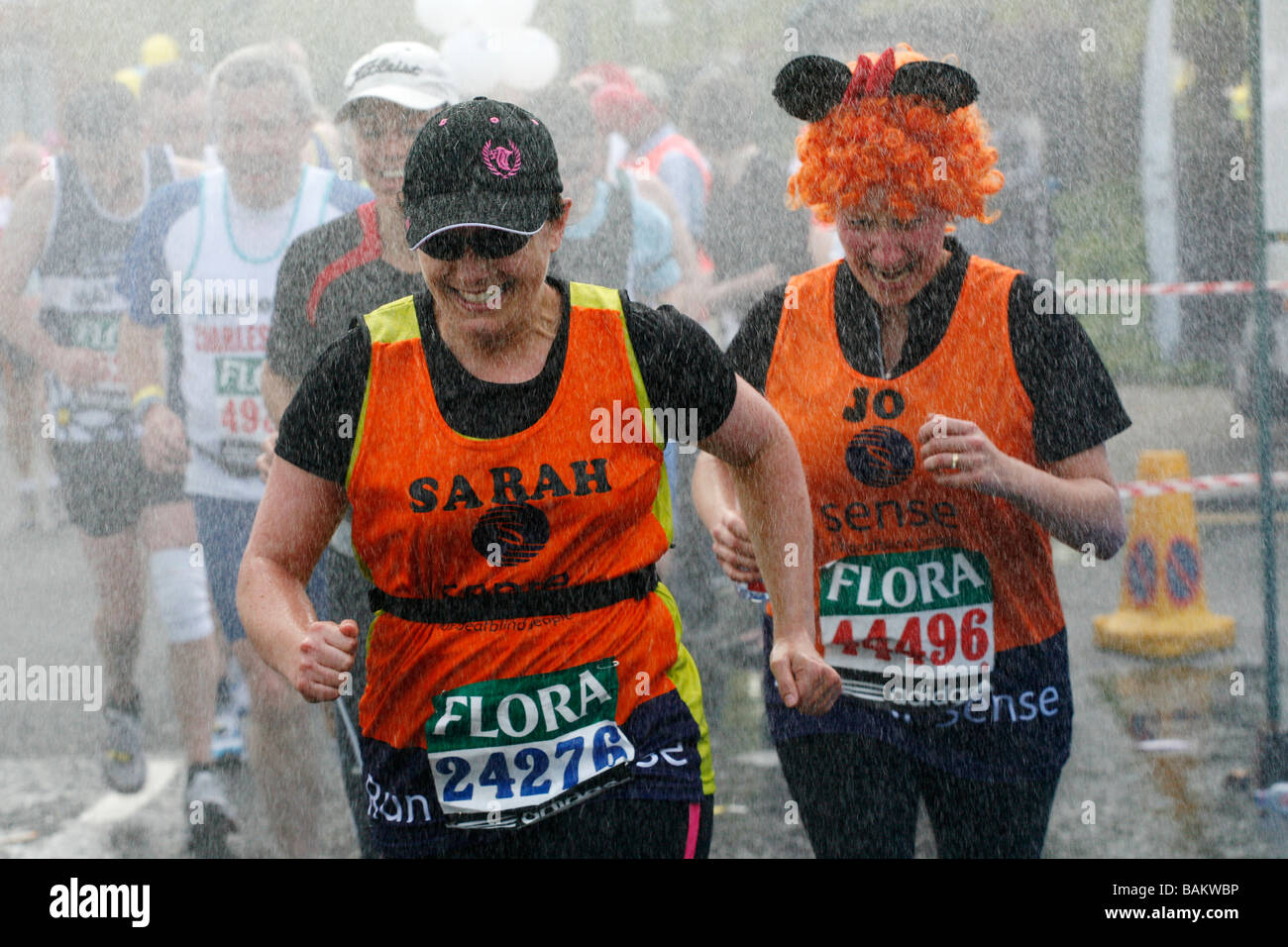 Runners using the cooling showers during the 2009 London Marathon. Stock Photo