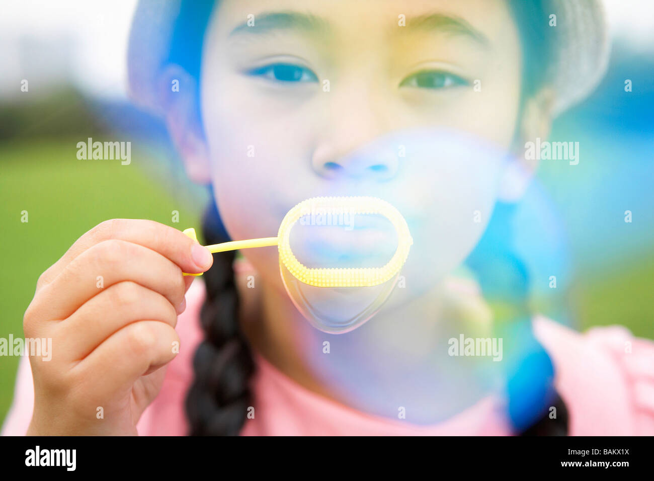 Little Girl Blowing Bubbles Stock Photo